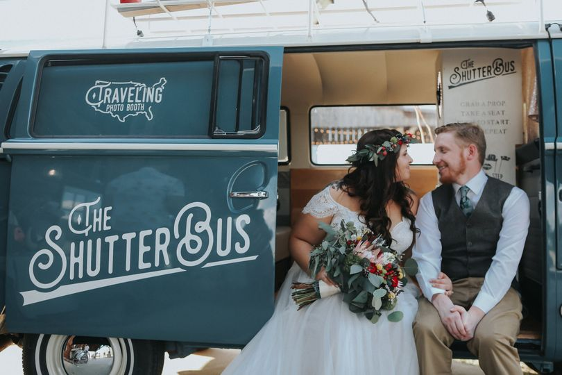 Newlyweds in the photo booth bus