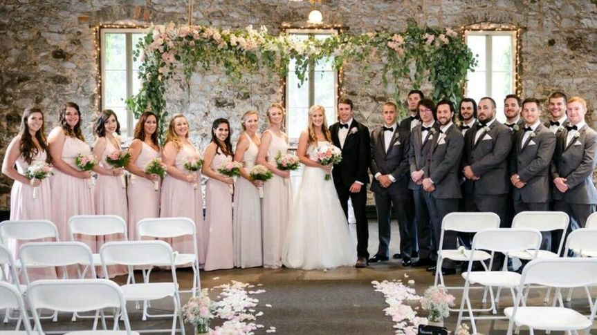 Floating arbor and bridal party, Floral design by Anything's Possible Events