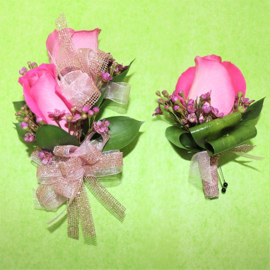 Pink boutonniere and corsage