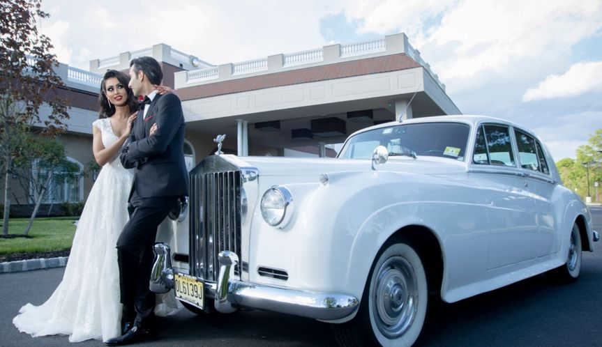 Couple with the bridal car