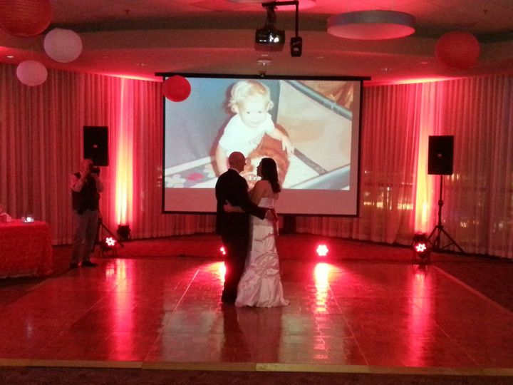 Father and daughter dance with slideshow