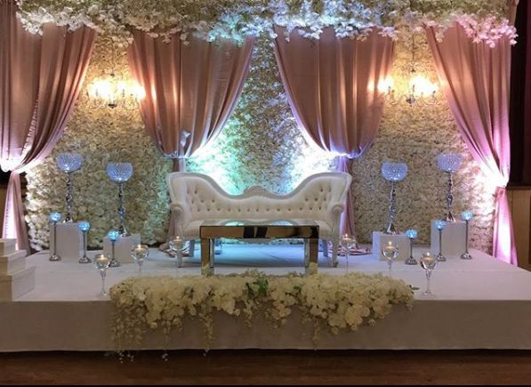 Newlyweds' reception couch on staghe