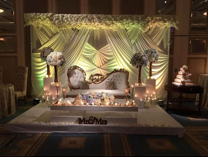 Candlelit reception stage and decor