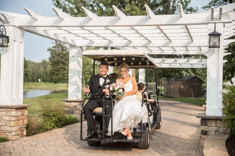 Couple riding a golf cart