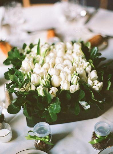 Classic white tulip centerpiece  Photo by Robertandkathleen.com