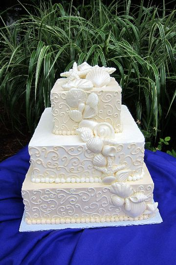 Textured square cake with ascending flowers