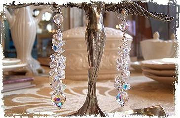 Custom bridal earrings of cascading Swarovski crystals.