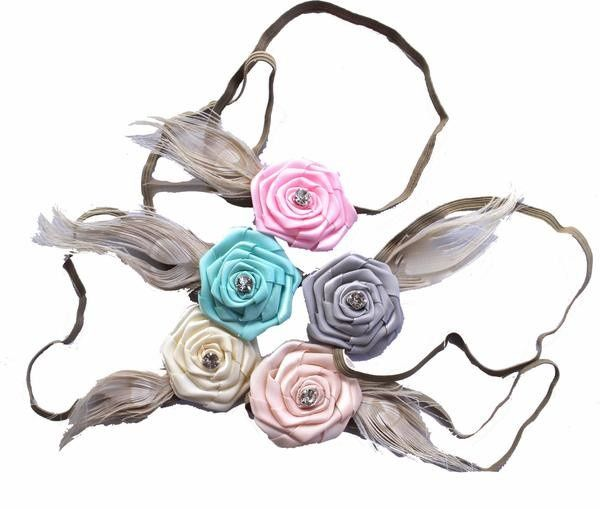 Feather flower florettes by Headbands of Hope. Perfect for your flower girl! For each headband sold,...