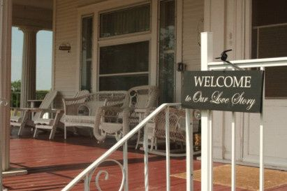 Welcome sign on the porch