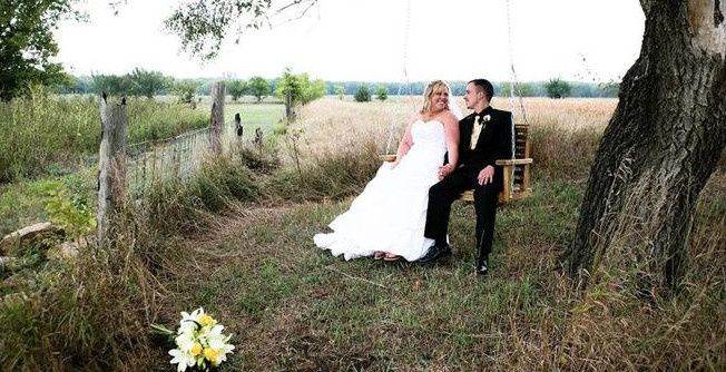 Newlyweds on the tree swing