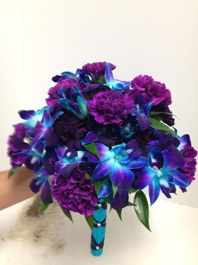 Blue and purple orchids with purple carnations