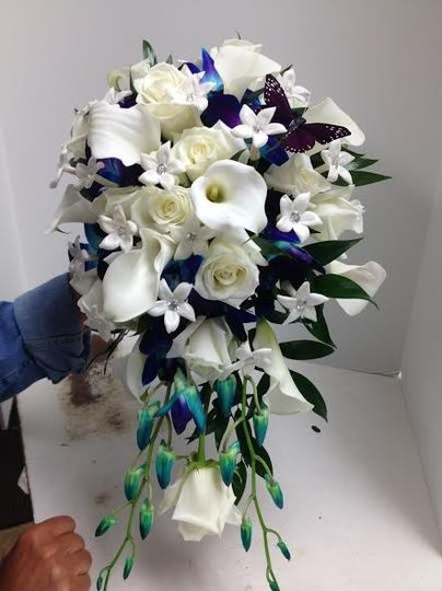 Cascade bouquet of white calla lilys white roses