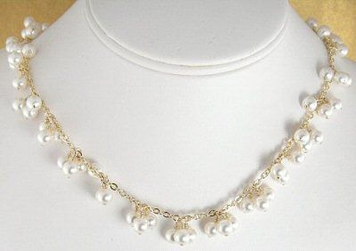 This beautiful bridal necklace is made with 6mm Swarovski pearls that have been wire wrapped onto...