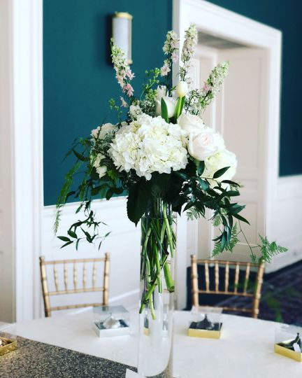 Tall centerpiece with white hydrangea