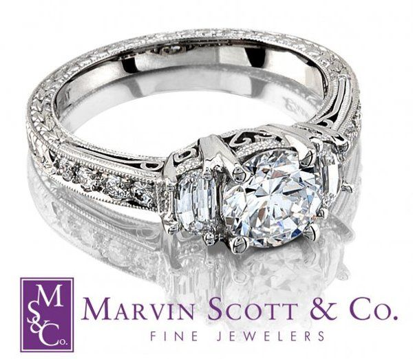 Round Brilliant Diamond Engagement Ring with Half Moon Side Diamonds. The Piece is Hand Engraved...