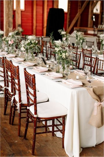 Reception table setup and floral centerpieces