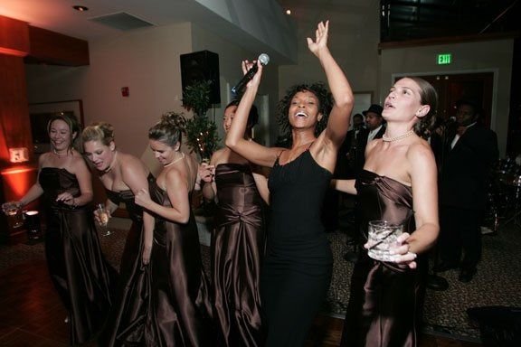 The lead singer interacts with the bridal party and has all the guests participating.