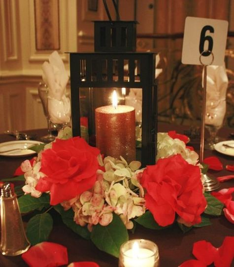Red flowers with candle