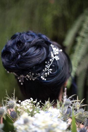 High bun with flower hair ornament