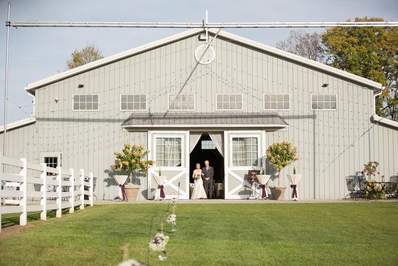 Newlyweds at the barn entrance