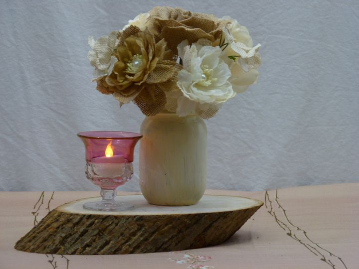 A simple centerpiece can be made with the use of a painted mason jar, wood disk, votive candle and...