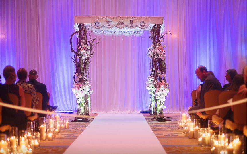 Indoor wedding setup with warm lights