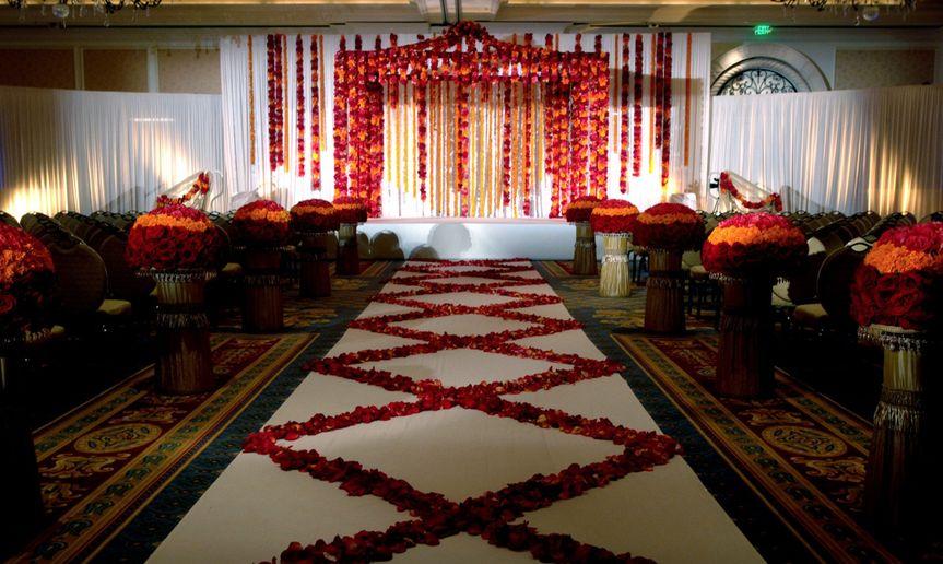 Red and orange theme indoor wedding