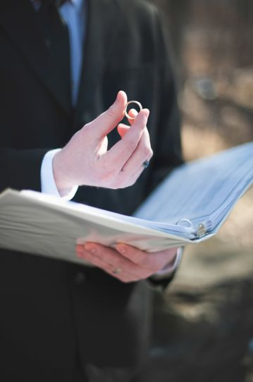 Officiant holding the wedding ring