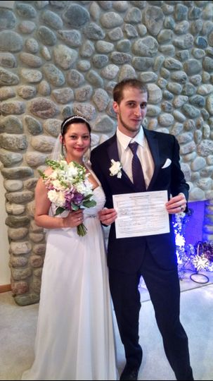 Couple showing off their marriage certificate