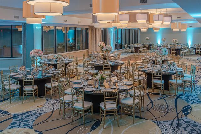 Beautiful lakeside terrace ballroom with a wall of windows overlooking the lake and wooded grounds