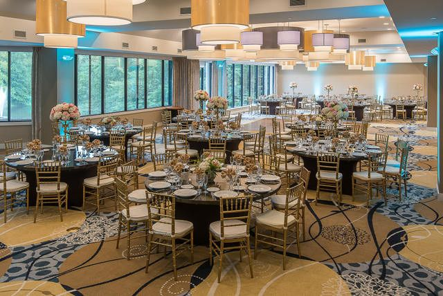 Beautiful lakeside terrace ballroom with a wall of windows overlooking the lake and wooded grounds.