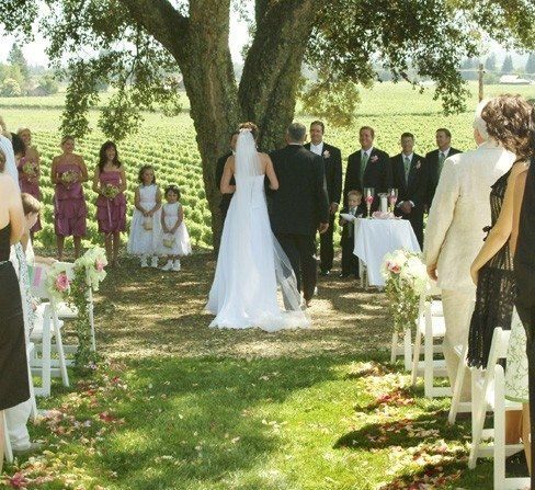 Hold your ceremony beneath a 100 year old Cork Oak Tree. The backdrop of vineyards and rolling...