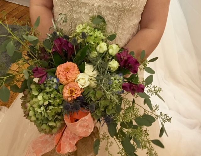 Beautiful bridal bouquet in a loose natural design.