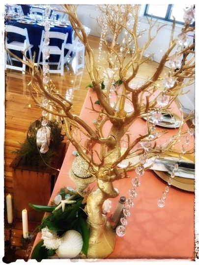 Gold Trees dripping with crystals and fairy lights add a subtle shimmer.