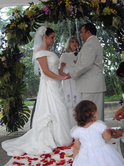 Couple underneath a wedding arch