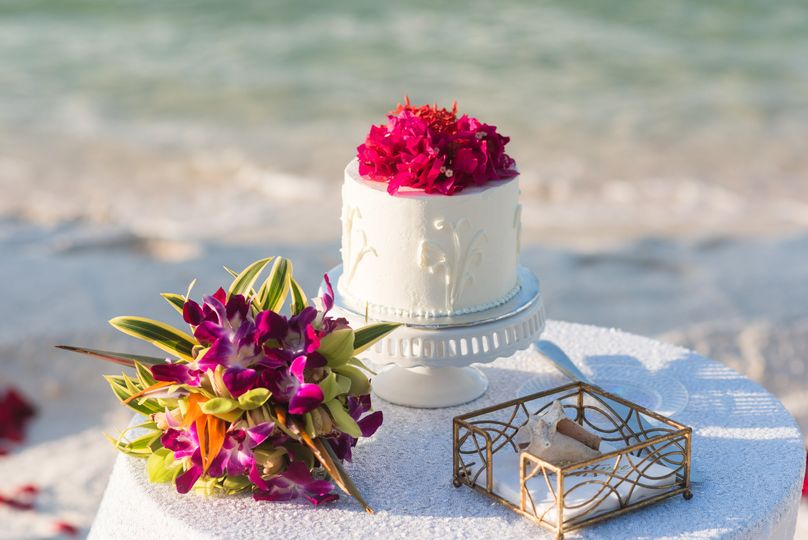 A tropical bouquet and cake.