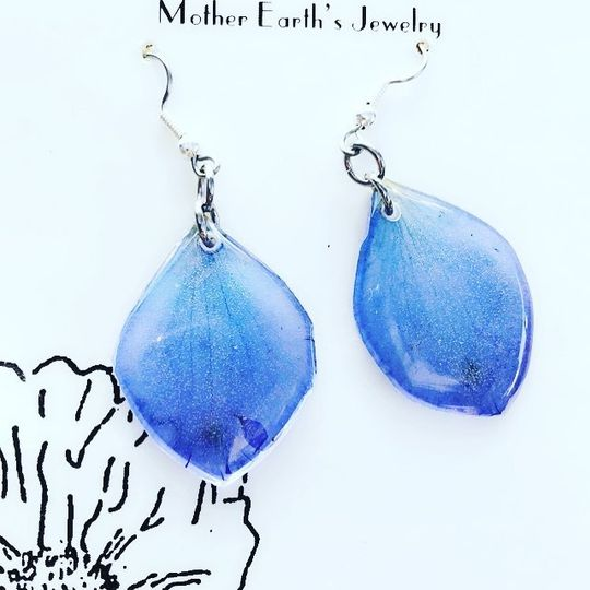 Earrings made from delphiniums