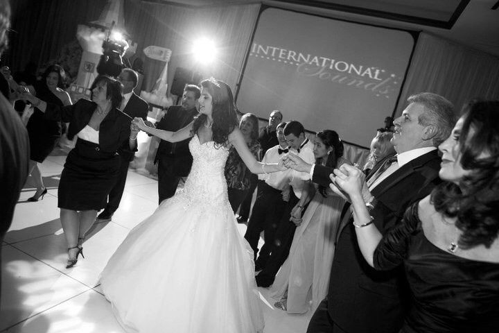Bride leads party into a  traditional Greek dance