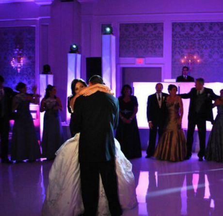 Couple dancing with DJ setup and lighting