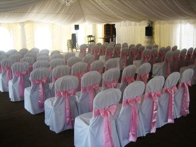 Pink sashes on ceremony chairs