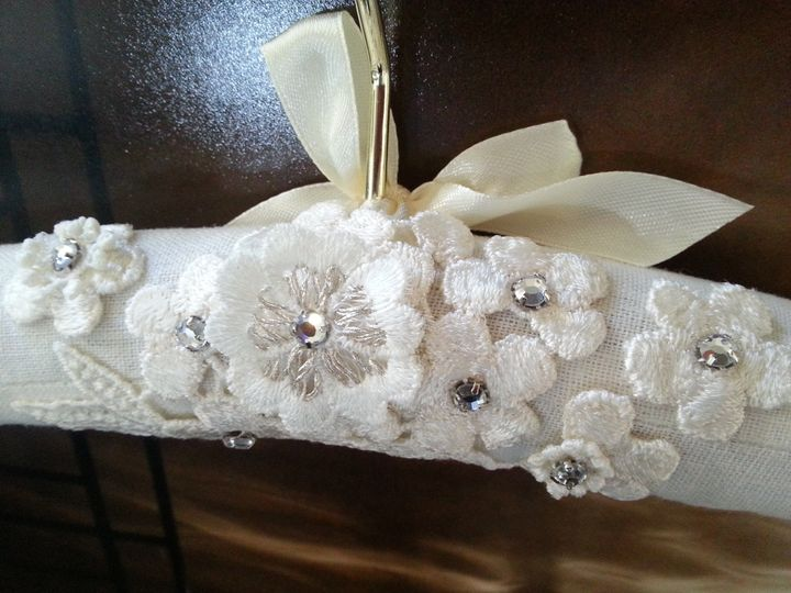 Hand embellished padded wedding gown hanger.  Embellished with ivory appliques, silver metallic...