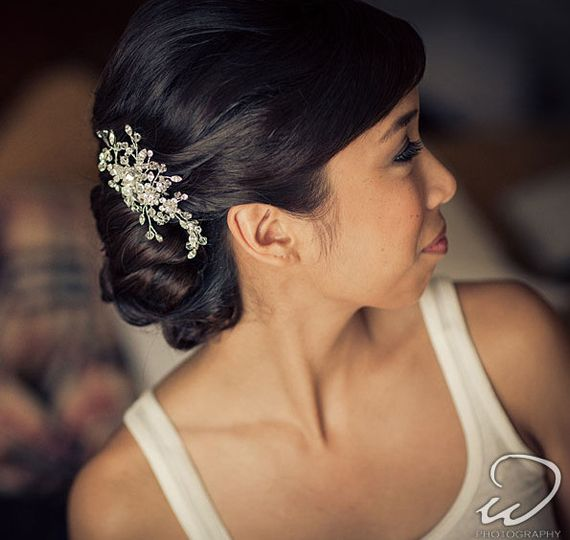 Swarovski crystals and rhinestones make this a sparkling wedding day hair comb.  Ends of the vines...