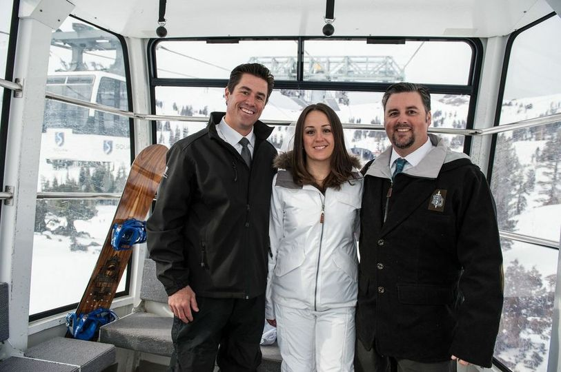 Newlyweds and officiant on the cable car