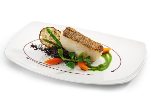 Seared and baked chilean sea bass, morel mushrooms, and black truffles, peas coulis, baby carrots...