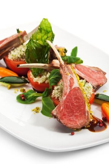Rack of Lamb a la Provencale, Roasted tomato, vegetable tournee, port wine sauce.