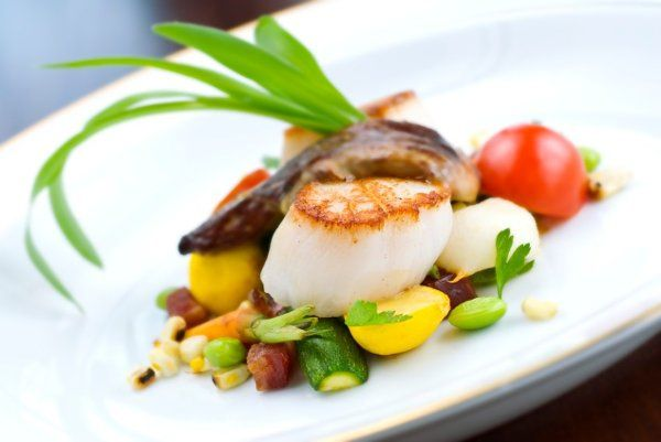 Seared scallops French Vanilla bean sauce, vegetable timbale.