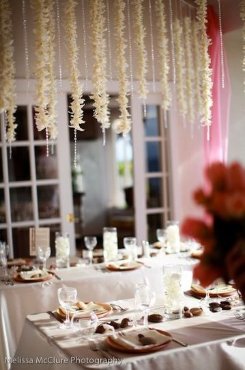 Reception Tables with hanging orchids and crystals