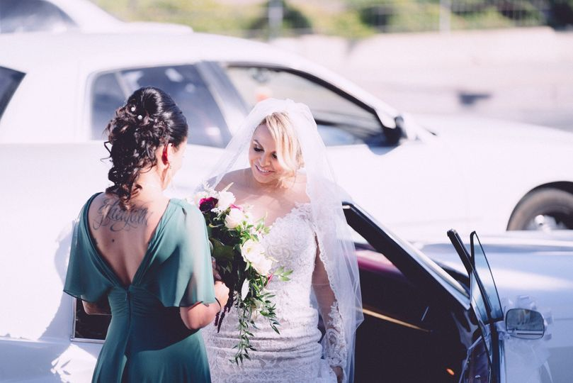 Bride and bridesmaid with bouquet