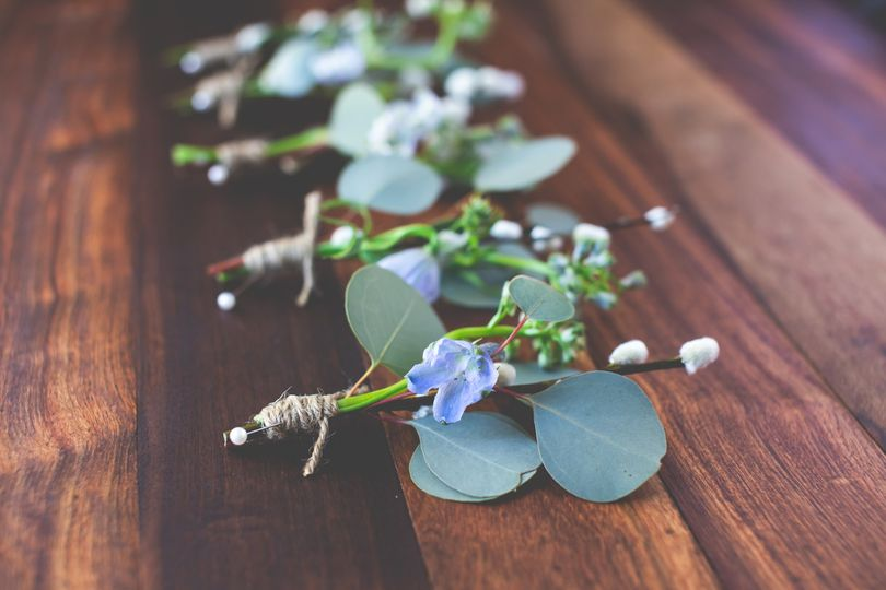Muted blue buttonholes