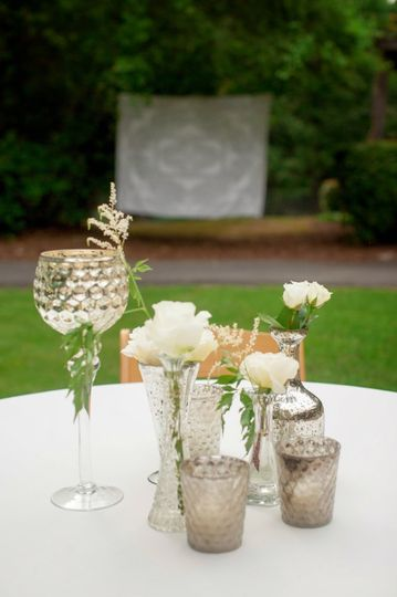 Table centerpiece and tall glass